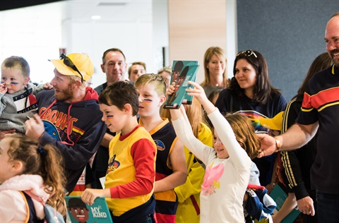 Crowd waiting for Eddie Betts book signing at Aldinga library