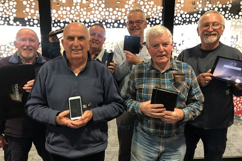 Residents with their digital devices at Aldinga Library.