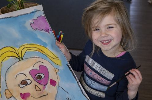 Macey from the Frieda Corpe Kindergarten shows off her artwork