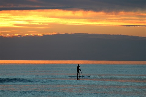 Stand up paddleboarder at Seaford beach